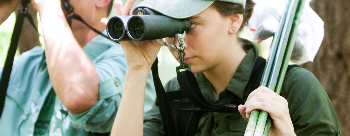 A person looking through binoculars