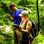 Two people studing wildlife in a Forest