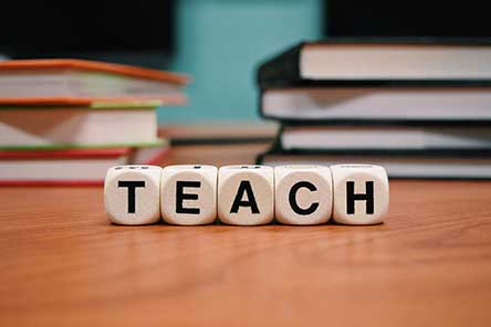 The word teach next to books