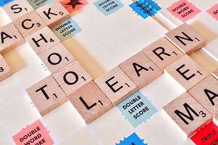 Scrabble tiles spelling the words school and learn