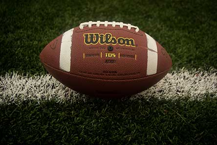 A football sitting on a painted yard line