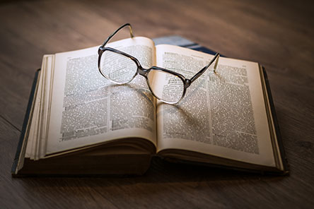 Eyeglasses upon an open book