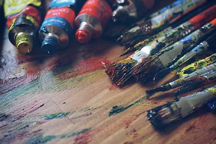 artist paint brushes and tubes of oil paints