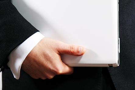 man holding labtop