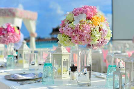 A table set with colorful flowers