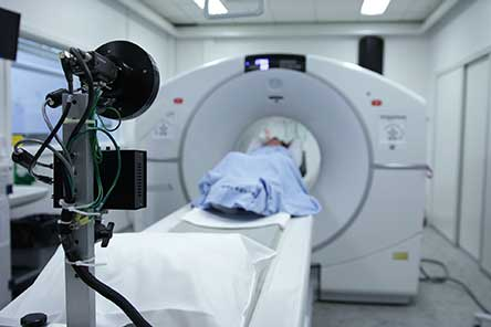A patient in medical scanning equipment