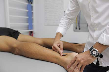 doctor checking pulse in ankle