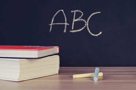 The letters A, B, and C written on a chalkboard