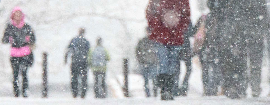 Students walking in a snowstorm