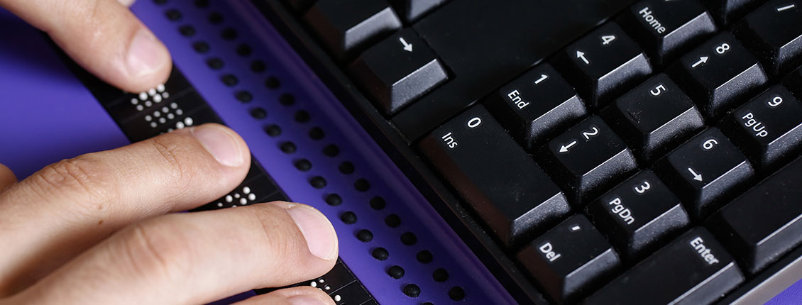 Hands using an assistive technology keyboard