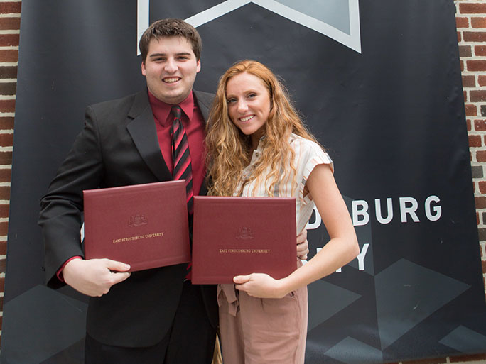 male and female student at honors reception