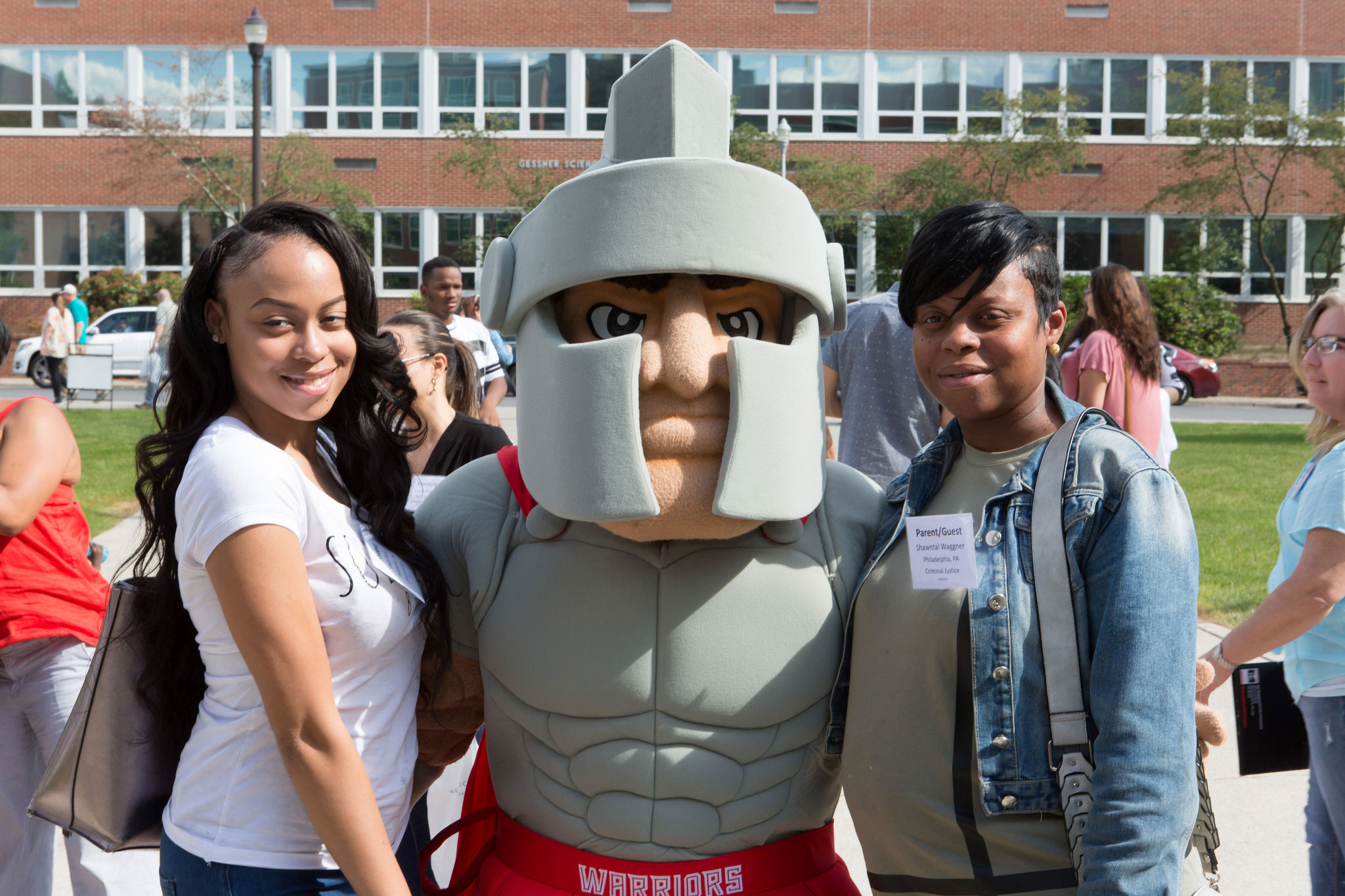 Students posing with the Warrior mascot