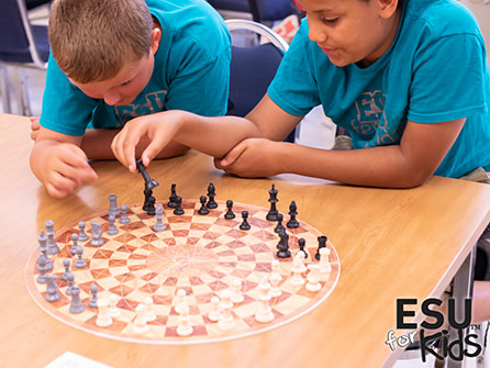 Camp kids playing a chess-like game