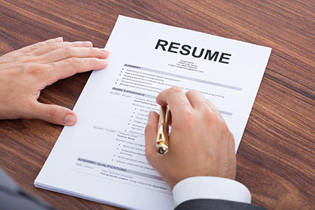 A person reviewing a resume
