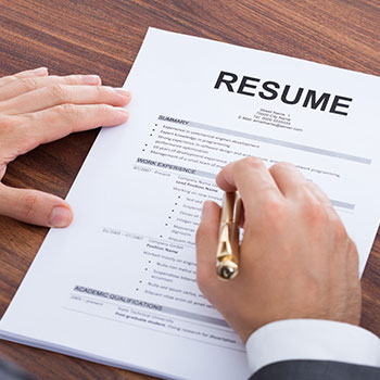 A person reviewing a resume.