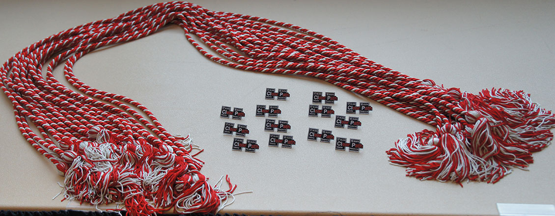 red and white graduation cords laying on table