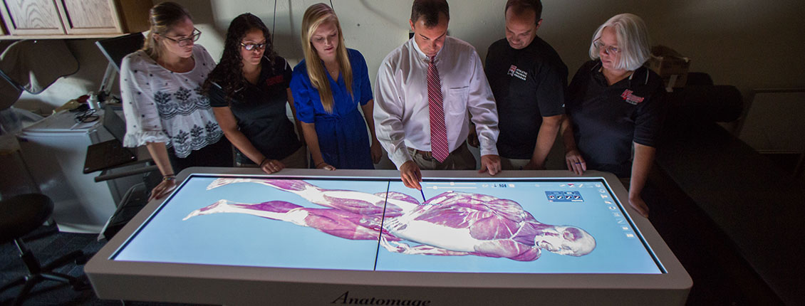 Students and faculty using the Anotomage table