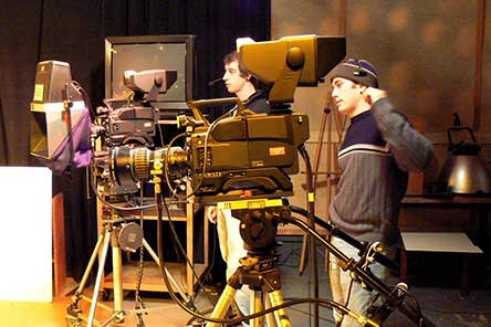 students behind tv cameras