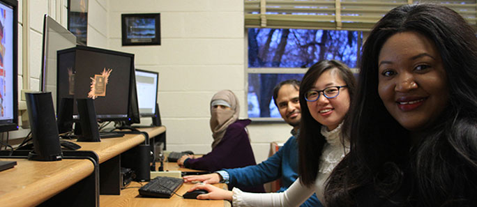 International students working on PCs