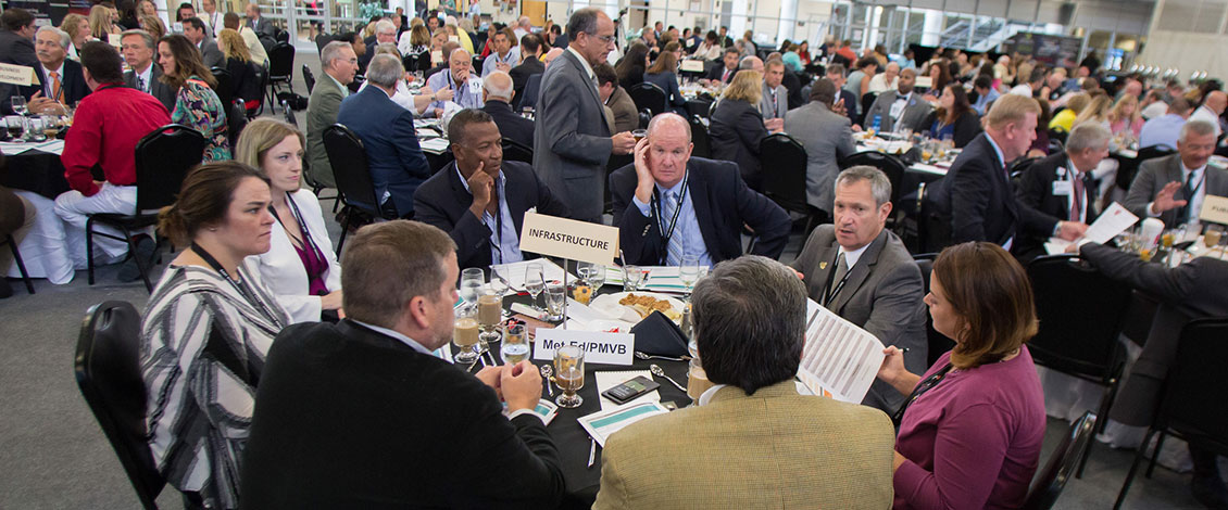 Attendees at a table discussing infrastructure at the 2018 Economic Outlook Summit