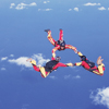 Three people skydiving