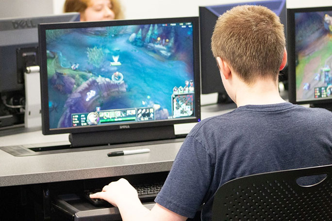 A student playing a video game