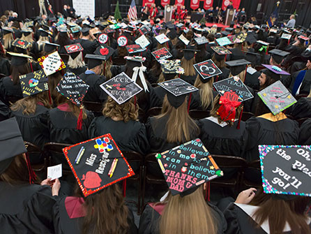 Students in decorated caps at Commencement