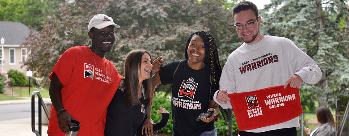 4 Students laughing and wearing ESU shirts