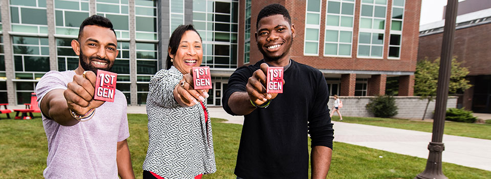 Faculty and staff who were in the first generation of their families to go to college wear buttons that say '1ST GEN' to identify themselves on campus for current first-generation students.
