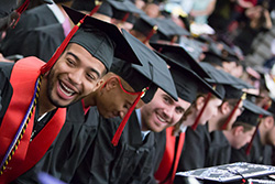 Students smiling during Spring 2017 commencement.