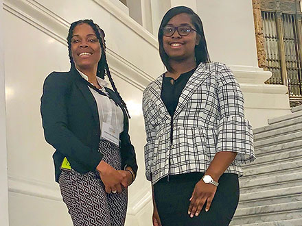 Students Rebecca Aduclasse and Khaleah Edwards standing and smiling at the Pennsylvania Center for Women and Politics at Chatham University