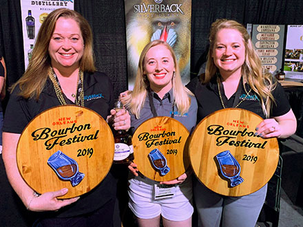 The Riggleman women showing off their 2019 Bourbon Festival award.