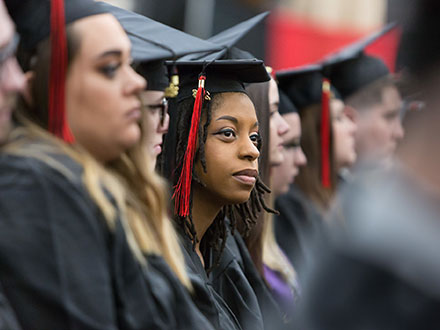Students listening and watching at commencement