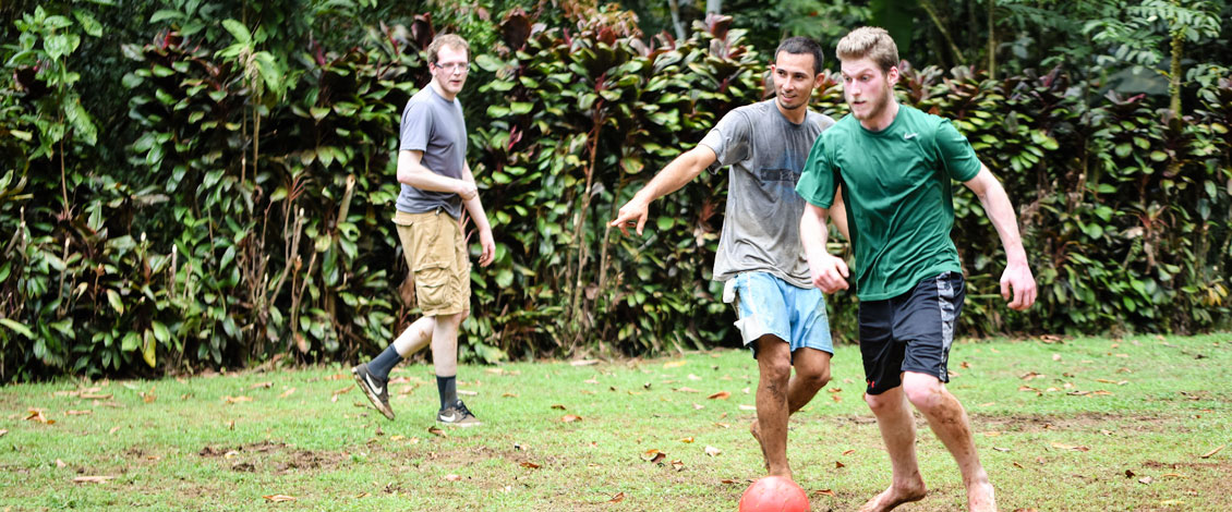 Three students playing soccer in Costa Rica.