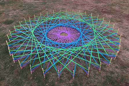 string art of a geometric circle in multiple colors
