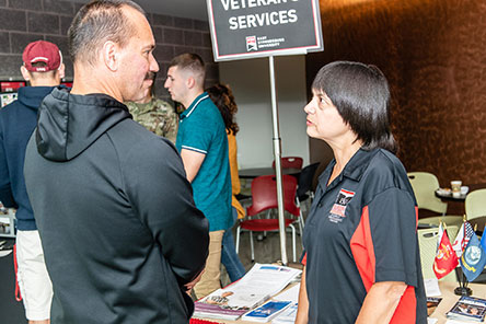 An accepted student speaking to the veterans services director