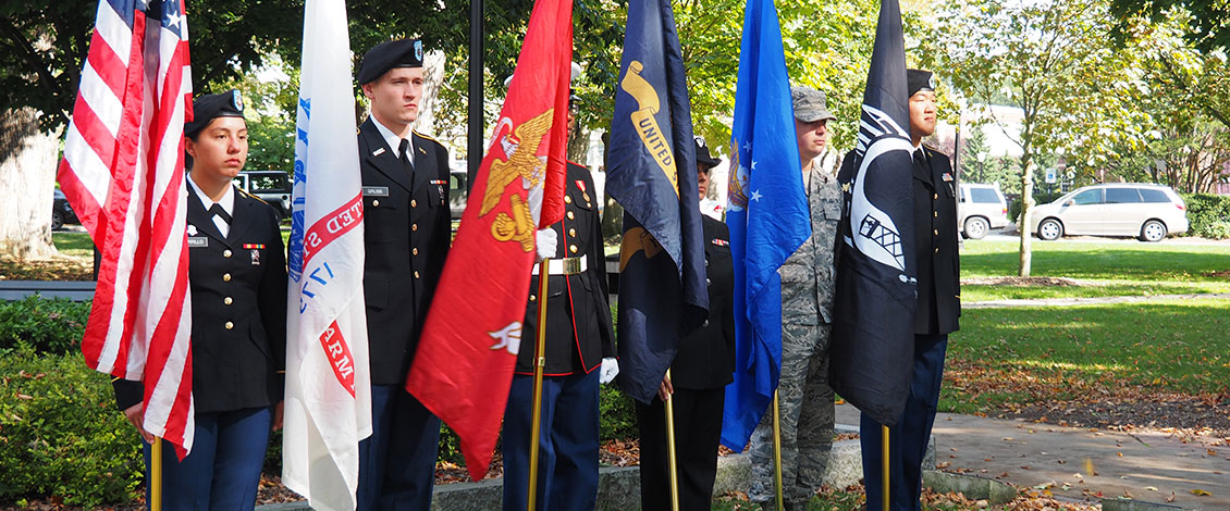 ESU students holding flags representing each of the armed forces