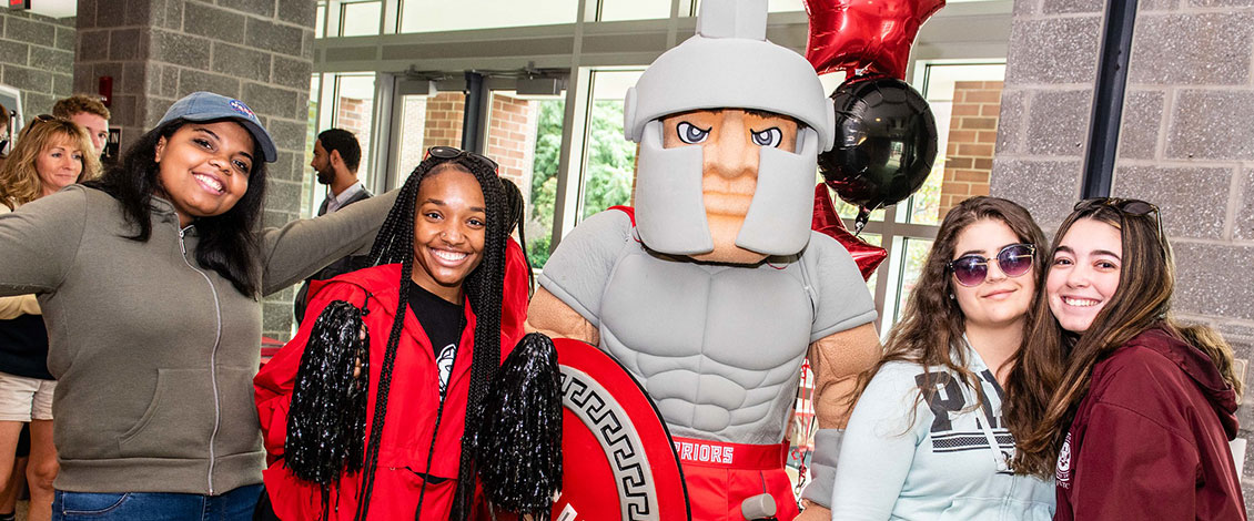 Student at open house with Warrior mascot